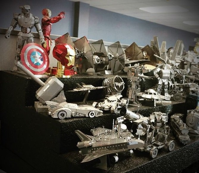 A collection of Metal Earth models on a shelf